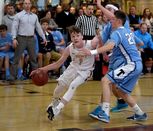 JIM VAIKNORAS/Staff photo Newburyport's  Robbie Shay drives to the basket against Triton Saturday. The Clippers won the game 59-57  at Newburyport high school.