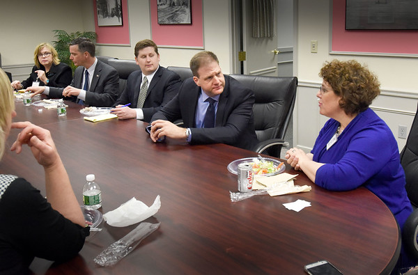 BRYAN EATON/Staff photo. New Hampshire governor Chris Sununu and his staff recently paid a visit to Rehab 365, a division of Arete Rehabilitation, Inc, which is headquartered in Amesbury. Dr. Janet Mahoney, DPT, CEO and Founder of Arete Rehab and Rehab 365, right, talking to Sununu, is committed to providing outpatient physical therapy, occupational therapy and speech therapy services specializing in restoring functional independence to people 65 and older at home, in a community setting or in their clinic . Rehab 365 will be opening a second clinic in southern New Hampshire later this year and Sununu wanted to learn more about the organization.