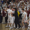 JIM VAIKNORAS/Staff photo  Newburyport players celebrate their  59-57 victory over Triton Saturday at Newburyport high school.
