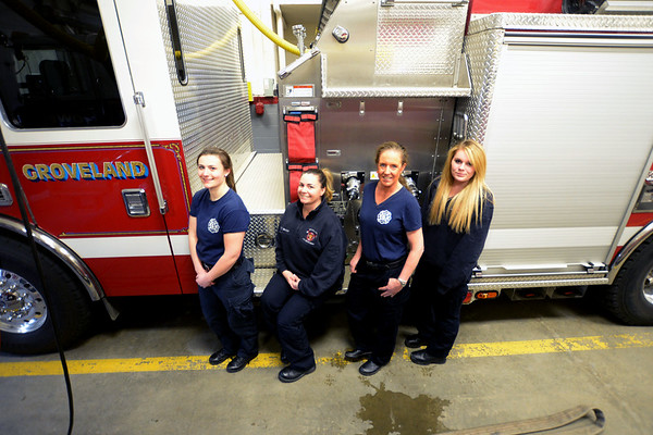 JIM VAIKNORAS/Staff photo Four new fire fighters in Groveland will be graduating Monday night  from call/volunteer fire fighting training program run by the state. from the right Courtney Panaro, Alyssa Bosh, Jennifer Hicks, and Megan Shea.