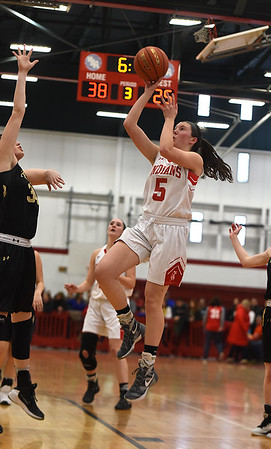 JIM VAIKNORAS/Staff photo  Amesbury's Julia LaMaontagne hits a runner during the Indian's victory over Bishop Fenwick Saturday at Wakefield high school. Amesbury won the game 66-50.
