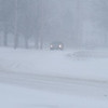 BRYAN EATON/Staff photo. Wind blows the snow sideways at Lion's Mouth Road in Amesbury.