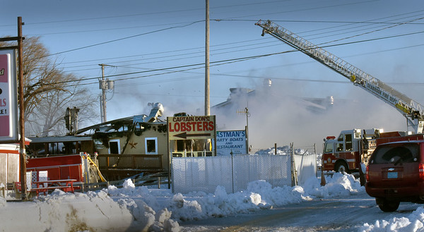 BRYAN EATON/Staff photo. Fire departments throughout the area assisted Seabrook in battling a fire at Catalano's Market Wednesday morning on Route 1A.