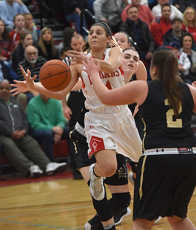 JIM VAIKNORAS/Staff photo  Amesbury girl's basketball captain Madison Napoli is fouled driving to the basket during the Indian's victory over Bishop Fenwick Saturday at Wakefield high school. Amesbury won the game 66-50.