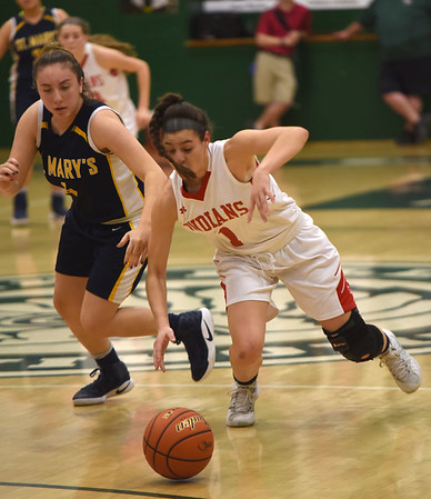 JIM VAIKNORAS/Staff photo Amesbury's Madison Napoli and  Mia Mowicki #4 of Chelsea dive for a loose ball at Billerica high school Tuesday night.