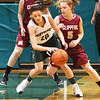 BRYAN EATON/Staff photo. Pentucket's Casey Hunt gets the ball away from Newburyport guard Olivia Olson.