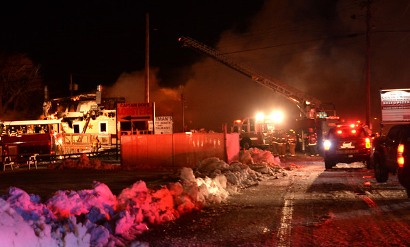 BRYAN EATON/Staff photo. Fire crews responded to a fire at the Catalano Market complex at Seabrook Beach early Wednesday morning. Route 1A was temporarily closed to traffic.