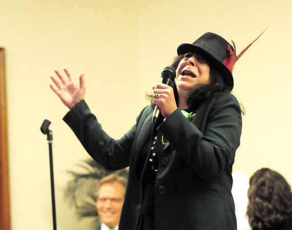 "JIM VAIKNORAS/Staff photo Newburyport Mayor Donna Holaday performs ""Mack the Knife""  during Irish Idol at the Link House Inc's 15th annual St. Patrick' Day Luncheon at the Masonic Temple in Newburyport Friday."