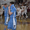 JIM VAIKNORAS/Staff photo Triton player walk off the court as Newburyport players celebrate their  59-57 victory over Triton Saturday at Newburyport high school.