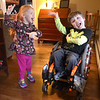 JIM VAIKNORAS/Staff photo  Braeden Farrell gives his sister Kernan dance in their Newburyport home. Both kids have Spinal Muscular Atrophy, they will be having a fund raiser on March 24th.
