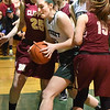 BRYAN EATON/Staff photo. Pentucket's Liv Cross busts her way through Newburyport defenders to score two points.