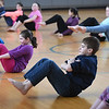 BRYAN EATON/Staff photo. Fifth-graders at Salisbury Elementary School took a yoga class on Friday with staff from Roots To Wings Yoga and Healing, based in Newburyport, during physical education class. Every Friday each entire class level meets for Unified Arts which brings youngsters together for comraderie and cooperation with each other. It's hoped they take with them relaxation techniques from the yoga class for their upcoming MCAS tests.