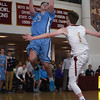 JIM VAIKNORAS/Staff photo Triton's Will Parsons  makes an off balance shot against Newburyport  Saturday. The Clippers won the game 59-57  at Newburyport high school.