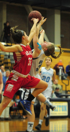 JIM VAIKNORAS/Staff photo Triton's Erin Savage collides with  Melrose's Alexis Doherty at Triton Tuesday night.