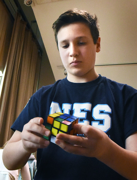 BRYAN EATON/Staff photo. Newbury Elementarty School student Nicolas Hubbard-Brucher, 12, solves a 3-by-3 Rubik's cube in 35 seconds. He was in a competition on Thursday afternoon at Salisbury Elementary School that included nine schools from Massachusetts, Maine and New Hampshire.