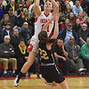 JIM VAIKNORAS Amesbury's Allison Napoli shoots over Bishop Fenwick's Samantha Mancinelli during the North final Saturday at Wakefield high school. Amesbury won the game 66-50.