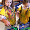 BRYAN EATON/Staff photo. Victoria Penney, 5, left, and Avery Pelletier, 4, paint the picture of a trap for Leprechauns on Monday as the class works on artwork for St. Patrick's Day. They were in Julie Deschene's pre-kindergarten at Salisbury Elementary School.