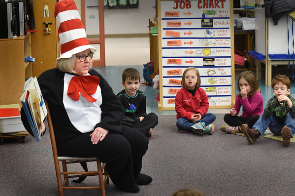 "BRYAN EATON/Staff photo. Margot Ryan, reading specialist at Newbury Elementary School, participated in ""Read Across America"" which celebrates Dr. Seuss's birthday Thursday. She was reading ""There Are No Cats in This Book"" to pre-kindergartners dressed as the Cat in the Hat."