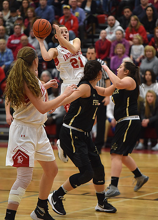 JIM VAIKNORAS/Staff photo Amesbury's Allison Napoli makes a pass to teammate Flannery O'Connor during their game against  Bishop Fenwick during the North final Saturday at Wakefield high school. Amesbury won the game 66-50.