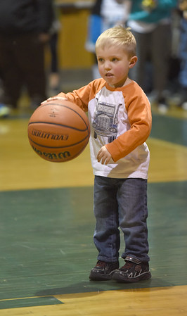 JIM VAIKNORAS/Staff photo Emmit McDonald, 2, shows off his basketball skills during the half time of Pentucket's girls basketball game against Arlington Catholic Saturday. Pentucket lost their game 48-43.