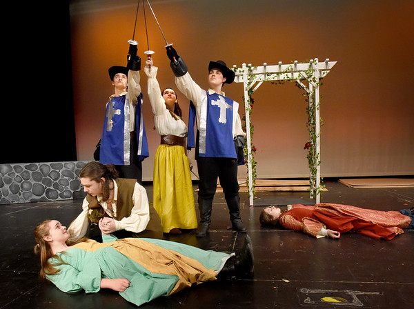 "BRYAN EATON/Staff photo. The Amesbury High School Drama Club is taking their production of the ""Three Musketeers"" to a competition this weekend. In rehearsal on Thursday, front left, Hannah Manclark as Constance with Chris Marrama as D'Artagnan. Back, from left, Benjamin Clark as Aramis; Lauren Mirley as Sabine; Michael Lynch as Athos and Jasmine Bellino as Milady."