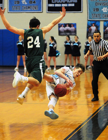 JIM VAIKNORAS/Staff photo Triton's Gabe Butts dives for a loose ball with Pentucket's Nate McGrail at Triton Tuesday night.