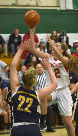 JIM VAIKNORAS/Staff photo Amesbury's Flannery O'Connor shoots a runner against St Mary's at Billerica high school Tuesday night.