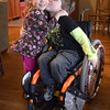 JIM VAIKNORAS/Staff photo  Braeden Farrell gives his sister Kernan a kiss in their Newburyport home. Both kids have Spinal Muscular Atrophy, they will be having a fund raiser on March 24th.
