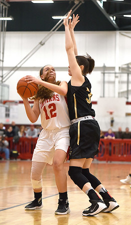 JIM VAIKNORAS/Staff photo  Amesbury's Fannery O'Connor posts up Bishop Fenwick Jennie Meagher during their game Saturday at Wakefield high school. Amesbury won the game 66-50.
