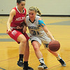 JIM VAIKNORAS/Staff photo Triton's Erin Savage drives to the basket during the Viking's game against  against Melrose at Triton Tuesday night.