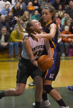 JIM VAIKNORAS/Staff photo Pentucket's Alyssa Demeule is fouled during their home game against Arlington Catholic Saturday.