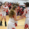 JIM VAIKNORAS/Staff photo Amesbury girl's basketball team celebrates their victory over Bishop Fenwick in  the North final Saturday at Wakefield high school. Amesbury won the game 66-50.