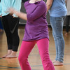 BRYAN EATON/Staff photo. Skylar Colburn, 10, shakes her body to loosen up after some stretching excercises.