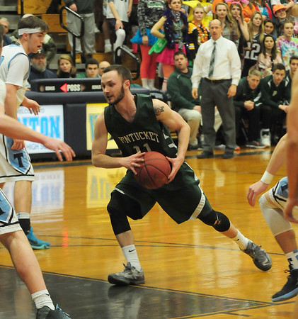 JIM VAIKNORAS/Staff photo  Pentucket's Conor O'Neil drives to the basket at Triton Tuesday night.