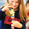 BRYAN EATON/Staff photo. Youngsters in the STEM (Science, Technology, Engineering and Math) class at Bresnahan School were in a Lego Challenge learning about engineering, design and process. Each student pulled a card with a different project to work on, Emily Chandler, 8, seeing how high she could make a tower before it toppled.