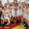 JIM VAIKNORAS/Staff photo Amesbury girl's basketball team and coaches celebrates their victory over Biship Fenwick in  the North final Saturday at Wakefield high school. Amesbury won the game 66-50.