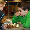 BRYAN EATON/Staff photo. Chess is a calculating and emotionless game, especially at the world championship level. But when you're nine years old and only been playing two weeks like Max Piotrowski, right, and Brynn Ponting, it can be full of emotion. The two were in one of the Bresnahan School's Afterschool Enrichment Programs sponsored by the Bresnahan PTO. Max thinks about his next move.