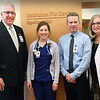 BRYAN EATON/Staff photo. Anna Jaques Hospital is deemed one of the top medical sites to work; they give out monthly awards to employees. Casey Souliotis, RN, was this month's. From left, Mark Goldstein, president and CEO; Souliotis; Richard Make, chief nursing officer and Katie LeBlanc, director of medical surgical services.