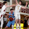 JIM VAIKNORAS/Staff photo Triton's Liam Spillane is surrounded by Newburyports's #1 Robbie Shay and #5 Cam McRae Saturday at Newburyport. The Clippers won the game 59-57.