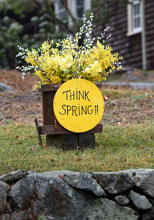 BRYAN EATON/Staff photo. There's some wishful thinking regarding spring on display on Hanover Street in Newbury. Though spring did begin early last week, there may be snow in the area Friday night into Saturday morning which is April 1st.