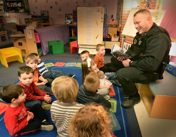 "BRYAN EATON/Staff photo. Amesbury's Cashman School hosted a ""Read Across America"" day with people from the community donating a half hour reading to different classes. Massachusett's state trooper Brian Bonia read ""Police Officer"" to Alice Bettencourt's pre-kindergarten class."