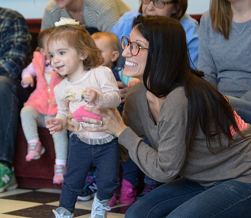 JIM VAIKNORAS/Staff photo Marianna Bavaro, 17 month, dances with her mom Erica during Wonderful Ones with Newburyport Children's Librarian Allison Driscoll Thursday at the library. The weekly event, at 9:30 and 11, features stories, puppets, singing, dancing, books and fun.