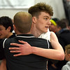 JIM VAIKNORAS/Staff photo  Newburyport's Robbie Shay hugs assistant coach Jesse Craddock after the Clippers 59-57 victory over Triton Saturday at Newburyport high school.