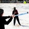 JIM VAIKNORAS/Staff photo Daniel Hutchings, 10 of Amesbury, pitches a softball to his sister Abby,13, on a fridged March Sunday morning in Amesbury Park.