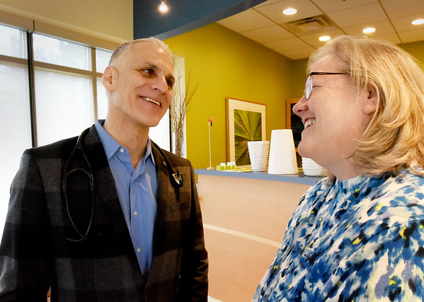 BRYAN EATON/Staff photo. Dr. George Papanicolaou meets with patient Trudy Summers of Gloucester in his Rowley office.