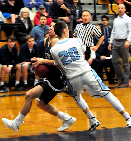 JIM VAIKNORAS/Staff photo Triton's Dylan Shute takes a charge on Pentucket's Nate McGrail at Triton Tuesday night.