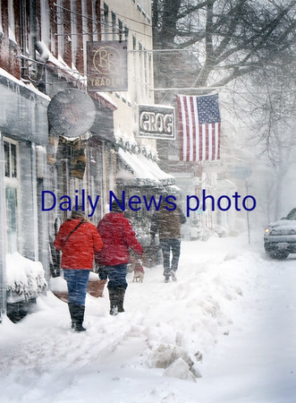 BRYAN EATON/Staff photo. People head to the Grog restaurant in downtown Newburyport which was open until 3:00p.m. A handful of other places were open as well.