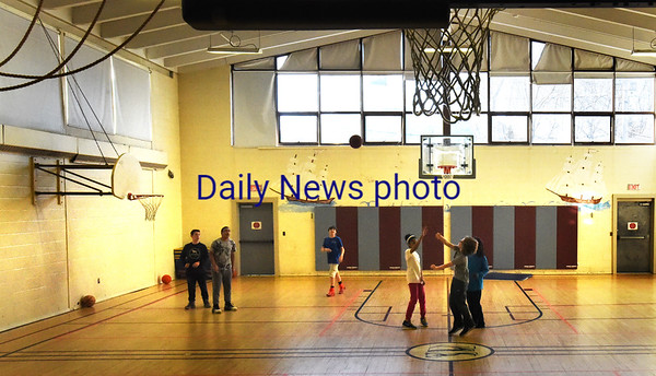 BRYAN EATON/Staff photo. Youngsters play basketball at the gymnasium at the Brown School on Monday afternoon in the Newburyport Youth Services program. A good amount of people surveyed by the city would like to see the city department stay there.