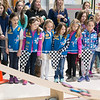 JIM VAIKNORAS/Staff photo Girls from Rowley Troop 62660 watch as pinewood cars race by at the Pine Grove School Saturday. Over 50 Rowley Girl Scouts competed their first Pinewood Derby.