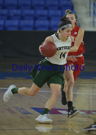 JIM VAIKNORAS/Staff photo Pentucket's Isabella Doyle drives to the basket against Wakefield Saturday at the Tsongas Center in Lowell. The win gave the Sachems the North Sectional Championship.